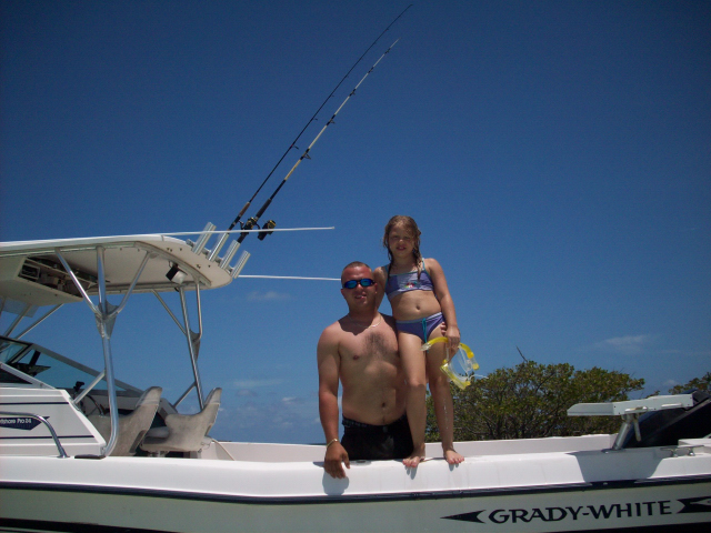 "Maddie with Big Brother ""Chris"" on his 26' Grady White with a 225 Mercury"